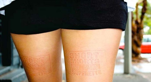 Advertising Imprint On Womans Legs
